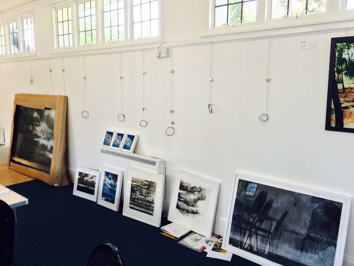 Hanging the exhibition at the Smallhythe Studio